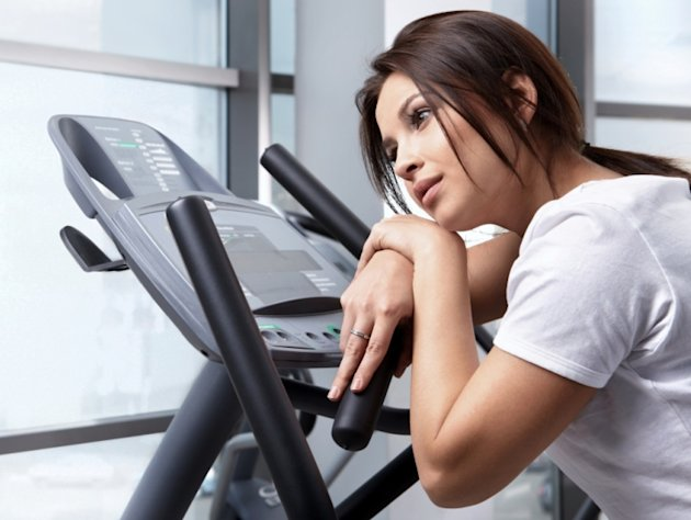 Woman on the elliptical at the gym. Photo: Masterfile
