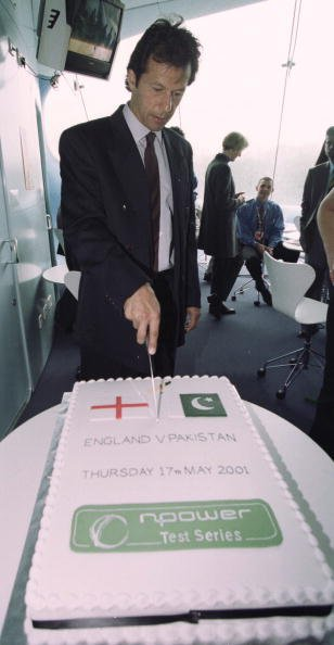 17 May 2001: Imran Khran cuts the NPower cake during the First Day of the First Test between England and Pakistan at Lords, London. Mandatory Credit: Tom Shaw/ALLSPORT