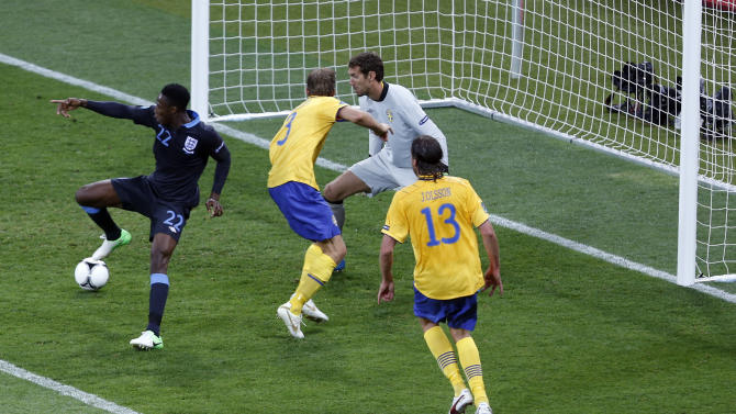 FILE - The June 15, 2012 file photo shows England's Danny Welbeck, left, scoring their side's third goal during the Euro 2012 soccer championship Group D match between Sweden and England in Kiev, Ukraine. (AP Photo/Darko Vojinovic)