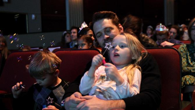 """Jason Priestley, center, and his children Dashiell Priestley, left, and Ava Priestley attend The Hub TV Network's """"My Little Pony Friendship is Magic"""" Coronation Concert at the Brentwood Theatre on Saturday, Feb. 9, 2013, in Los Angeles in support of Children's Hospital LA. (Photo by Matt Sayles/Invision for The Hub/AP Images)"""