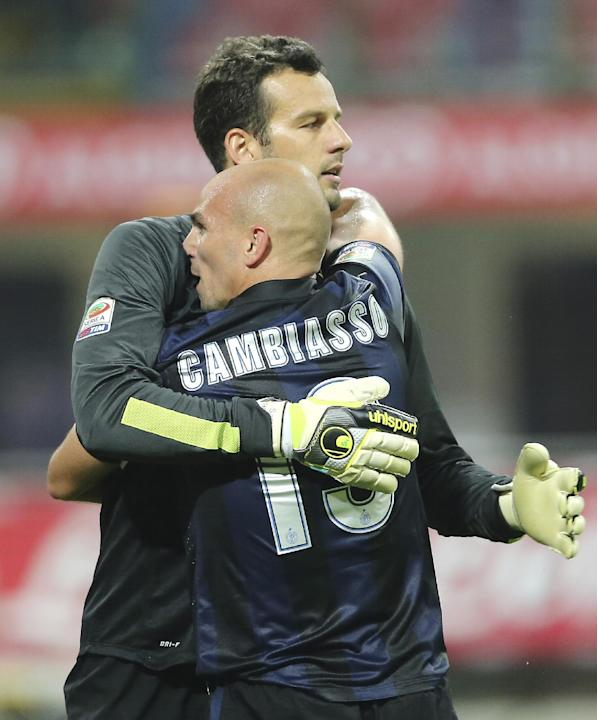 Inter Milan Argentine midfielder Esteban Cambiasso, right, celebrates with his teammate goalkeeper Samir Handanovic, of Slovenia, after winning the Serie A soccer match between Inter Milan and Fiorent