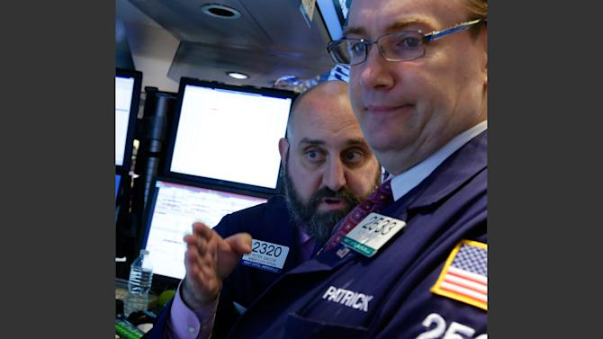 In this Wednesday, Oct. 9, 2013 photo, specialists Peter Giacchi, left, and Patrick King confer at a trading post on the floor of the New York Stock Exchange. After a strong finish on Friday, investors are hoping the stock market rally will continue Monday, Oct. 28, 2013. (AP Photo/Richard Drew)