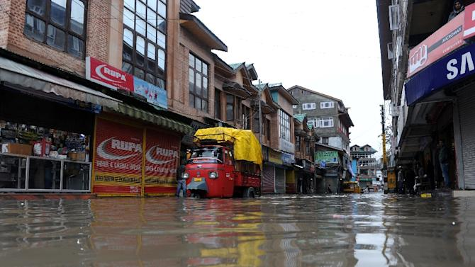 A flooded street in Srinagar, on March 29, 2015 in Indian Kashmir, where at least 10 people are missing after heavy rainfall caused mudslides