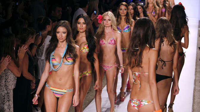 Models wear swimwear from the collection of  Luli Fama during the Mercedes-Benz Fashion Week Swim 2013 show, Sunday, July 22, 2012, in Miami Beach, Fla. (AP Photo/Lynne Sladky)