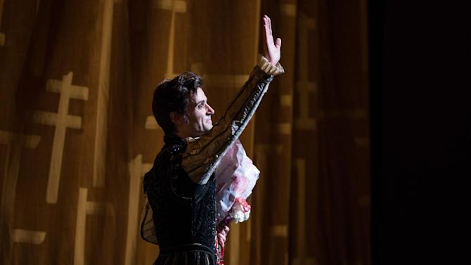 """In this June 28, 2012 photo provided by American Ballet Theatre, Angel Corella waves to the audience after his retirement performance of """"Swan Lake"""" with the American Ballet Theatre at the Metropolitan Opera House in New York. (AP Photo/American Ballet Theatre, Rosalie O'Connor)"""