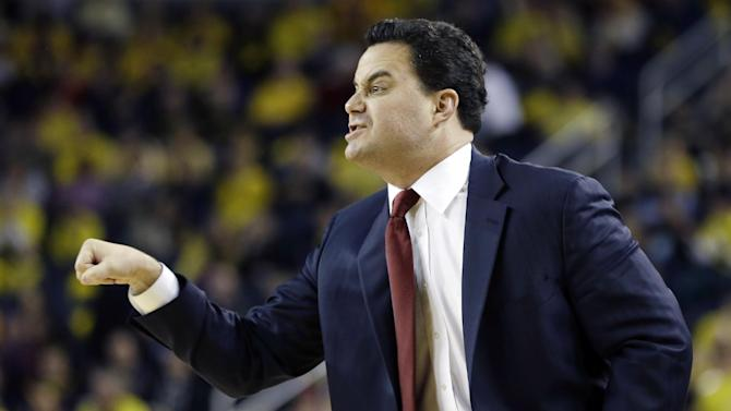 Arizona head coach Sean Miller directs his team from the sidelines during the first half of an NCAA college basketball game against Michigan in Ann Arbor, Mich., Saturday, Dec. 14, 2013