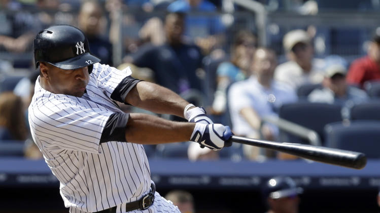 New York Yankees' Vernon Wells hits a ground-rule double to drive in three runs during the seventh inning of a baseball game against the Tampa Bay Rays Saturday, June 22, 2013, in New York. (AP Photo/Frank Franklin II)