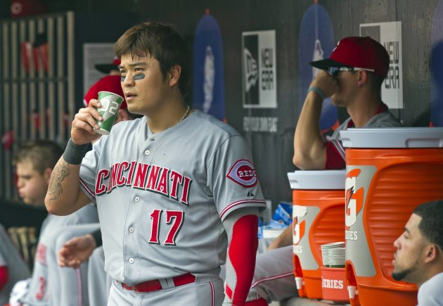 Cincinnati Reds Shin-Soo Choo gets drink in dugout as they play New York Mets in MLB game in New York