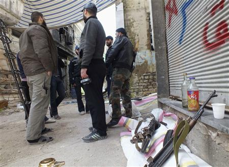 Free Syrian Army fighters stand by their weapons in the besieged area of Homs, March 9, 2013. Picture taken March 9, 2013. REUTERS/Yazan Homsy