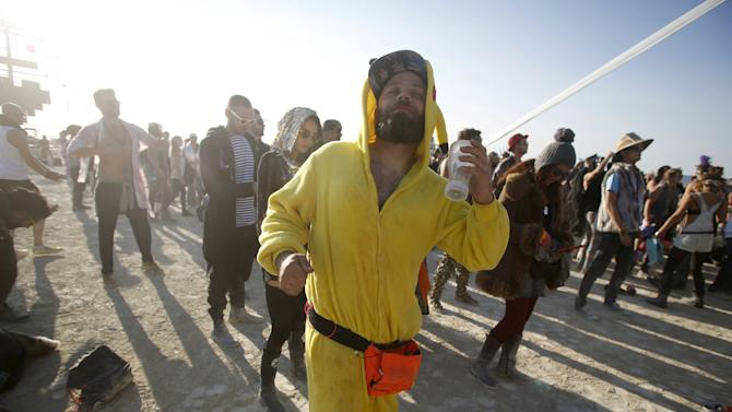 """Dan Drahos dances at the Robot Heart during the morning hours at the Burning Man 2015 """"Carnival of Mirrors"""" arts and music festival in the Black Rock Desert of Nevada"""