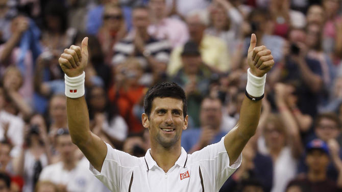 Novak Djokovic of Serbia reacts after defeating Bobby Reynolds of the United States in their Men's second round singles match at the All England Lawn Tennis Championships in Wimbledon, London, Thursday, June 27, 2013. (AP Photo/Kirsty Wigglesworth)