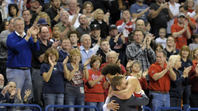 Gonzaga's Elias Harris and coach Mark Few hug as Harris exited the court in his last home game appearance in the second half of an NCAA college basketball game against Portland, Saturday, March 2, 2013, in Spokane, Wash. Gonzaga defeated Portland 81-52. (AP Photo/Jed Conklin)