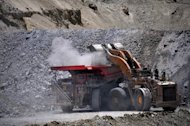 A truck is loaded at the Los Bronces copper mine belonging to Anglo American Coorporation. Mining giants Codelco and Anglo American said Thursday they had ended their legal battle over the British firm's sale of a $5.4 billion stake in its Chilean copper operations