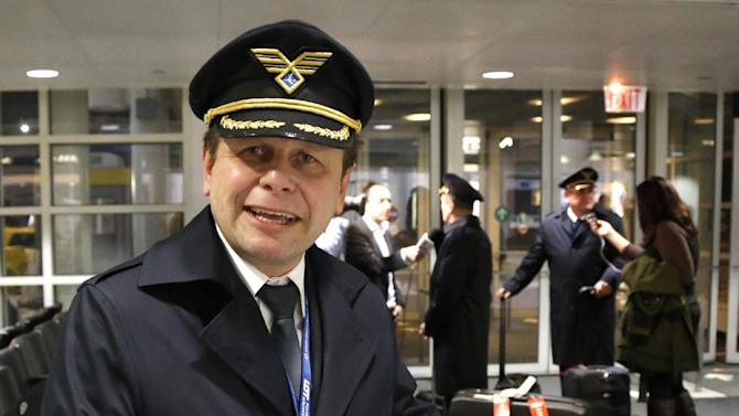 Polish Airlines Captain Stanislaw Radzio talks about the flight of LOT flight 003 from Warsaw, a Boeing 787, after their arrival at Chicago's O'Hare International Airport Wednesday, Jan. 16, 2013. The FAA grounded all Boeing 787 Dreamliner airplanes pending safety checks of the planes lithium batteries and passengers ticketed on the return flight to Warsaw were rebooked on other airlines. (AP Photo/Charles Rex Arbogast)
