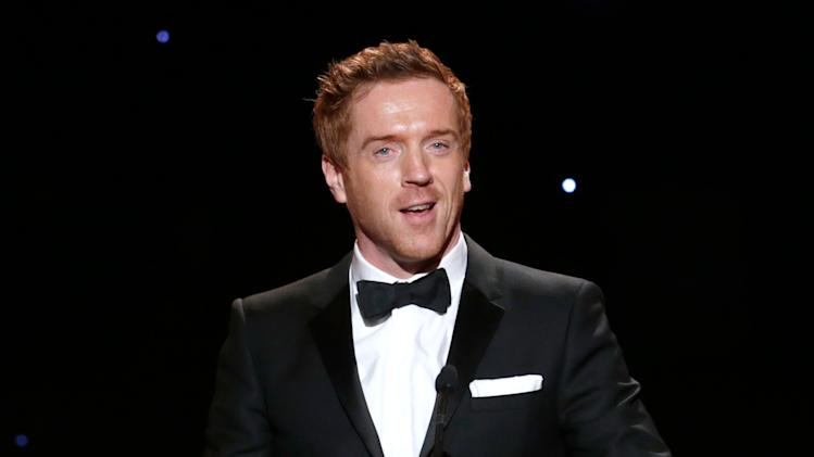 IMAGE DISTRIBUTED FOR THE PRODUCERS GUILD - Damian Lewis presents an award at the 24th Annual Producers Guild (PGA) Awards at the Beverly Hilton Hotel on Saturday Jan. 26, 2013, in Beverly Hills, Calif. (Photo by Todd Williamson/Invision for The Producers Guild/AP Images)