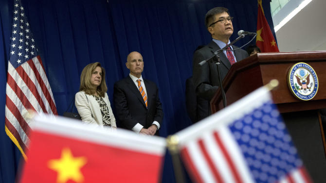 U.S. Ambassador to China Gary Locke delivers his speech on stage, as California Gov. Jerry Brown, second from left, and his wife Anne Brown, left, look on during a Trade and Investment reception at the U.S. Embassy in Beijing Wednesday, April 10, 2013. (AP Photo/Andy Wong, Pool)