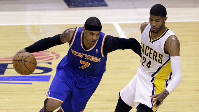 New York Knicks forward Carmelo Anthony, left, drives on Indiana Pacers forward Paul George during the first half of Game 4 of the Eastern Conference semifinal NBA basketball playoff series. in Indianapolis on Tuesday, May 14, 2013. (AP Photo/Michael Conroy)