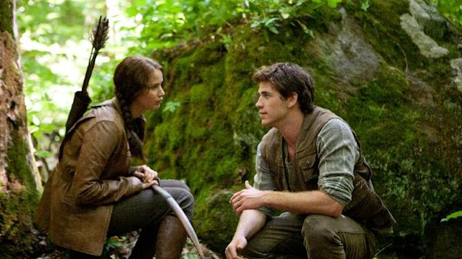 "FILE - In this file image released by Lionsgate, Jennifer Lawrence portrays Katniss Everdeen, left, and Liam Hemsworth portrays Gale Hawthorne in a scene from ""The Hunger Games."" ""The Hunger Games"" on Monday, April 30, 2012 was nominated for eight MTV Movie awards, including bids for best cast, breakthrough performance, and movie of the year. (AP Photo/Lionsgate, Murray Close, File)"