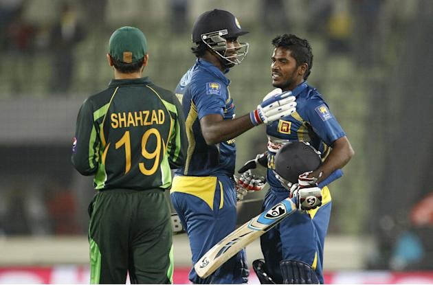 Sri Lankan cricket captain Angelo Mathews, center, celebrates with teammate Chaturanga de Silva, right, after winning the Asia Cup final match against Pakistan in Dhaka, Bangladesh, Saturday, March 8,