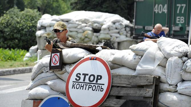 Pro-Russian separatists stand guard at their check-point near the eastern Ukrainian city of Donetsk on July 23, 2014