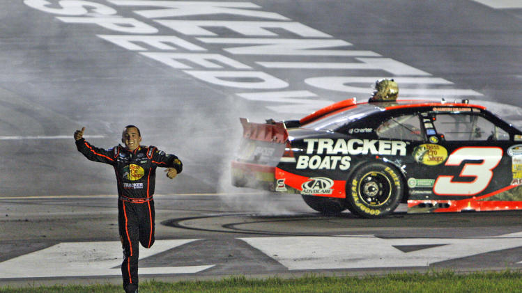 Austin Dillon runs to meet his pit crew after winning the NASCAR Nationwide Series auto race at Kentucky Speedway in Sparta, Ky., Friday, June 29, 2012. (AP Photo/Bud Kraft)