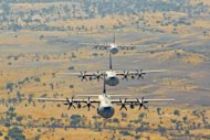 Indian Air Force C-130J Super Hercules transport aircraft fly in a low-level tactical formation during a military exercise near Hanumangarh, located near the India-Pakistan border, on May 3, 2012. India is investing in military hardware to modernise its armed forces, and the United States has become one of its major arms suppliers, with $8.5 billion in sales over the past 11 years