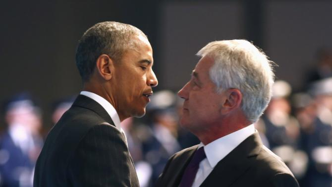 U.S. President Barack Obama hugs outgoing Defense Secretary Chuck Hagel during a farewell ceremony at Joint Base Myer-Henderson Hall in Virginia