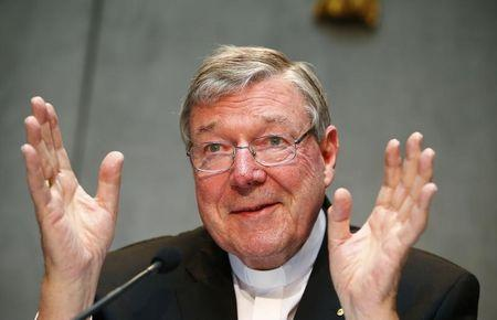 Cardinal George Pell gestures as he talks during a news conference for the presentation of new president of Vatican Bank IOR, at the Vatican