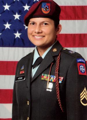 "CORRECTS CHANGED NAME TO NAIDA CHRISTIAN NOVA, NOT NADIA CHRISTIAN NOVA - Sgt. 1st Class Naida Hosan is shown in this undated U.S. Army photo provided by Sgt. Nova. With her family name emblazoned on her uniform, the sergeant says she was routinely the target of derogatory remarks from other soldiers who mistakenly assumed she is a Muslim. So before deploying for her second war tour, the life-long Catholic legally changed her name to Naida Christian Nova. The 82nd Airborne, who in a federal lawsuit she claims branded her a ""Muslim sympathizer,"" revoked her security clearance and tried to force her out of the Army with a less than honorable discharge. (AP Photo/US Army)"