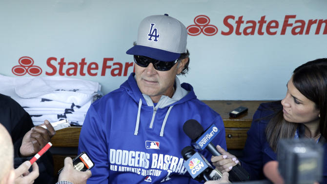 Los Angeles Dodgers manager Don Mattingly talks to the media in the dugout before a baseball game against the Chicago Cubs  in Chicago, Thursday, Sept. 18, 2014. (AP Photo/Nam Y. Huh)