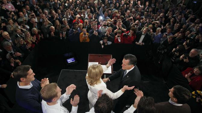 Former Massachusetts Gov. Mitt Romney reaches for his wife Ann as his sons, Josh, Ben, Craig, Tagg and Matt (L-R) look on during the Romney for President New Hampshire primary night rally at Southern New Hampshire University in Manchester, N.H., Tuesday, Jan. 10, 2012. (AP Photo/Charles Dharapak)