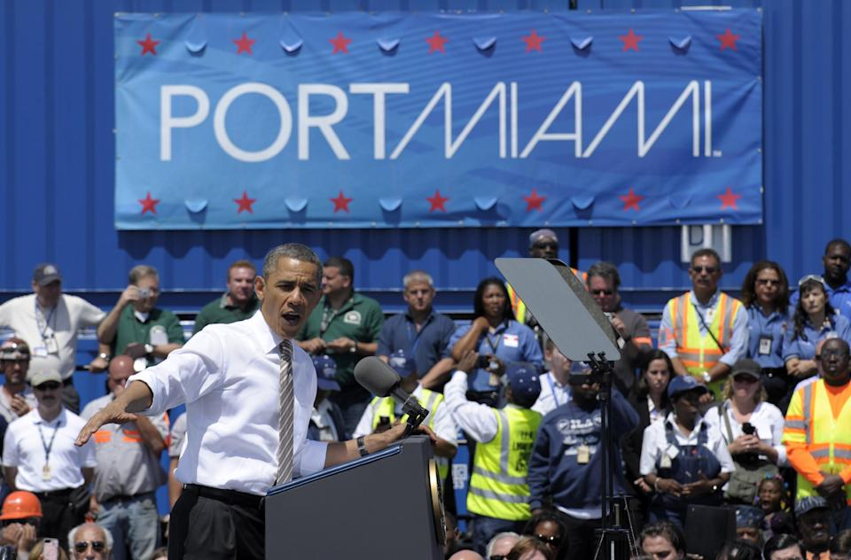President Barack Obama speaks at a port in Miami, Friday, March 29, 2013, promoting a plan to create construction and other jobs by attracting private investment in roads and other public works projects.  (AP Photo/Susan Walsh)