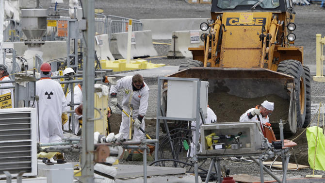 """FILE - In this March 6, 2013 file photo, workers labor at the 'C' Tank Farm at the Hanford Nuclear Reservation, near Richland, Wash. Documents obtained by the Associated Press show that there are """"significant construction flaws"""" in some newer, double-walled storage tanks at the nuclear waste complex. (AP Photo/Ted S. Warren, File)"""