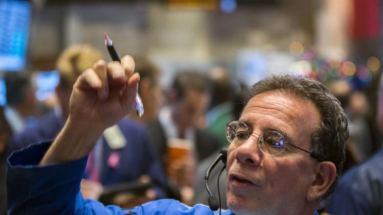 A trader works shortly after the market opening on the floor of the New York Stock Exchange