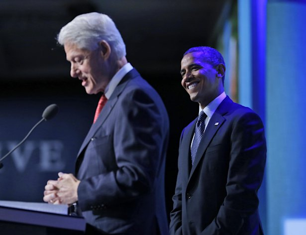 President Barack Obama is introduced by former President Bill Clinton before speaking at the Clinton Global Initiative Annual meeting in New York, Tuesday, Sept. 25, 2012. (AP Photo/Pablo Martinez Monsivais)