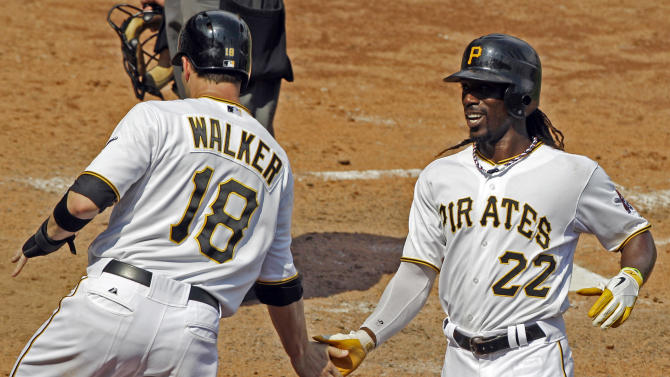 Pittsburgh Pirates' Andrew McCutchen (22) and Neil Walker (18) celebrate after scoring on a single with the bases loaded by Pirates' Pedro Alvarez off Houston Astros  pitcher Fernando Abad during the seventh inning of a baseball game in Pittsburgh Wednesday, July 4, 2012. The Pirates won 6-4. (AP Photo/Gene J. Puskar)