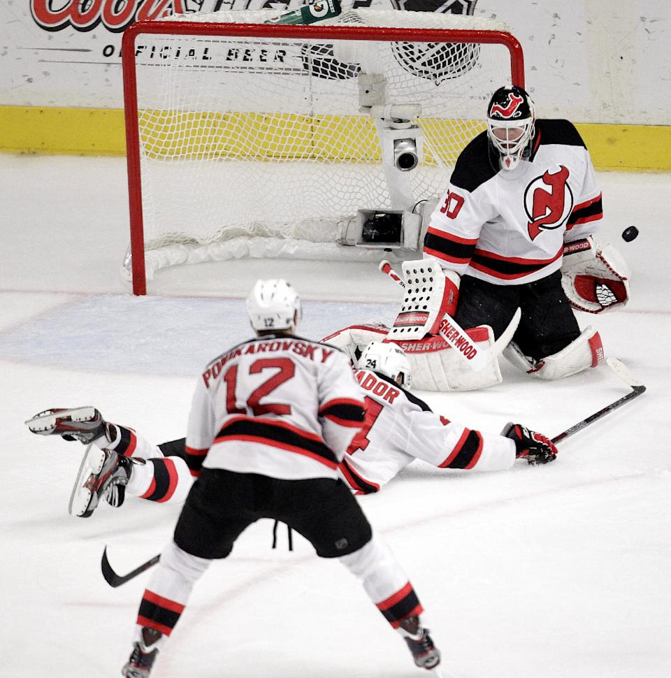 New Jersey Devils goalie Martin Brodeur makes a save against the New York Rangers during the second period of Game 5 of an NHL hockey Stanley Cup Eastern Conference final playoff series, Wednesday, May 23, 2012, in New York. (AP Photo/Julio Cortez)