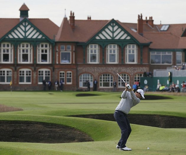 Adam Scott of Australia plays to the 18th green at Royal Lytham & St Annes golf club during the second round of the British Open Golf Championship, Lytham St Annes, England, Friday, July 20, 2012. (AP