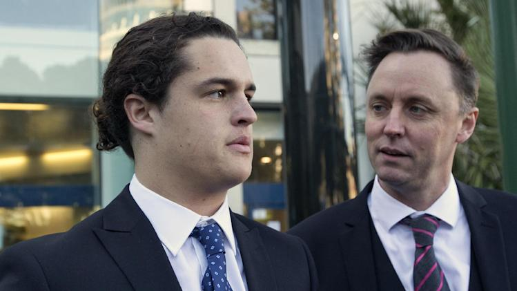In this Monday, June 23, 2014 photo, sixteen-year-old Lucan Battison, left, with his lawyer, Jol Bates, arrives at the High Court in Wellington, New Zealand, where Battison is fighting his suspension from his Catholic high school because of his long hair. In a decision released Friday, June 27, 2014, New Zealand High Court judge David Collins found that both Battison's suspension and the school's hair rules were unlawful. (AP Photo/New Zealand Herald, Mark Mitchell) NEW ZEALAND OUT, AUSTRALIA OUT