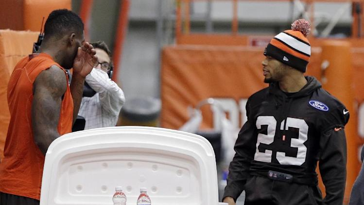 Cleveland Browns cornerback Joe Haden (23) leaves the practice field at the NFL football team's indoor facility in Berea, Ohio Thursday, Dec. 19, 2013. Haden, who left Sunday's game against the Chicago Bears with a hip injury, did not participate in the portion of practice open to the media