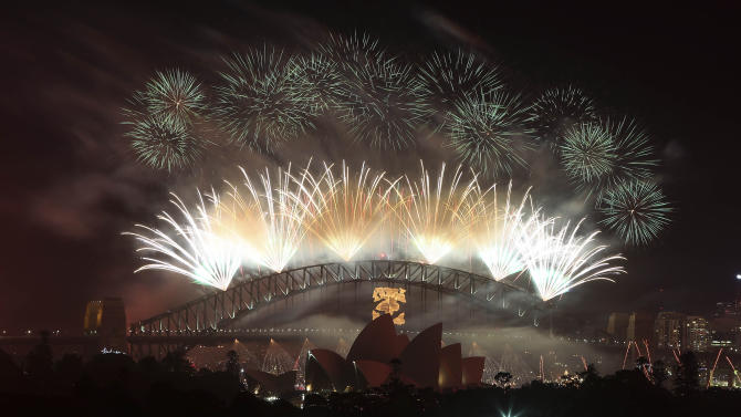 Fireworks explode in the sky above Sydney Harbour during the New Year celebrations in Sydney, Australia, Tuesday, Jan. 1, 2013.(AP Photo/Rob Griffith)