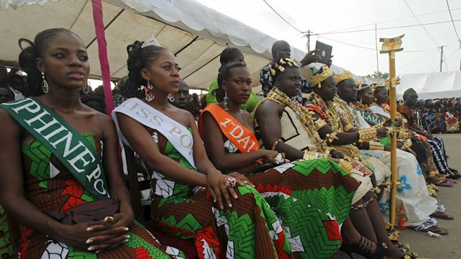 Miss Popo Carnival Yobo Zena Marie Lorraine sits with other candidates during a parade at the Popo (Mask) Carnival of Bonoua