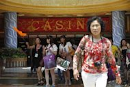 A group of Chinese tourists arrives at the lobby of Genting Singapore's Resorts World Sentosa casino in Singapore, April 29, 2013. RESULTS/ REUTERS/Edgar Su/Files