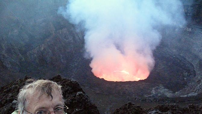 This June 30, 2011 photo shows Tony Wheeler, co-founder of Lonely Planet, at the crater rim of the very active Nyiragongo Volcano near Goma in the Democratic Republic of Congo across the border from Rwanda. (AP Photo/Lonely Planet, Timothy Churella)
