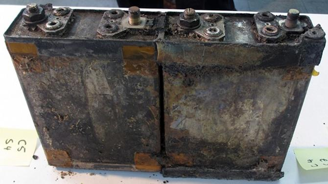 """This Jan. 31, 2013 photo provided by the Japan Transport Safety Board shows two of eight damaged cells in the battery, that overheated on the All Nippon Airways Boeing 787 on Jan. 16 and prompted an emergency landing, during an investigation by U.S. and Japanese aviation safety regulators at its manufacturer GS Yuasa's headquarters in Kyoto, Japan. An investigation into the battery found evidence of the same type of """"thermal runaway"""" seen in a similar incident in Boston, officials said Tuesday, Feb. 5, 2013. (AP Photo/Japan Transport Safety Board) EDITORIAL USE ONLY, NO SALES"""