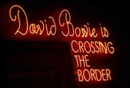 "A neon sign is seen at the ""David Bowie is"" Exhibition at the Victoria and Albert Museum in London, March 20, 2013. REUTERS/Neil Hall"