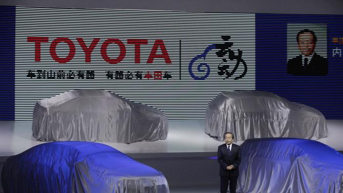 Toyota Motor Corp. Vice Chairman Takeshi Uchiyamada delivers a speech before unveiling the company's new cars at the Shanghai International Automobile Industry Exhibition (AUTO Shanghai) media day in Shanghai, China Saturday, April 20, 2013. (AP Photo/Eugene Hoshiko)