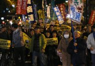 Protesters shout slogans during a march against the government's planned secrecy law in Tokyo November 21, 2013. REUTERS/Issei Kato