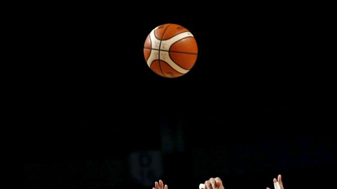 Canada's Philip Scrubb jumps for the ball with Puerto Rico's Larry Ayuso during their 2015 FIBA Americas Championship basketball game, in Mexico City
