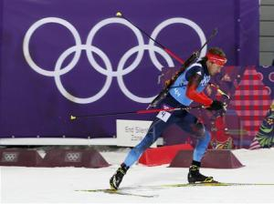 Russia's Shipulin skis during men's biathlon 4 x 7.5 km relay at Sochi 2014 Winter Olympic Games